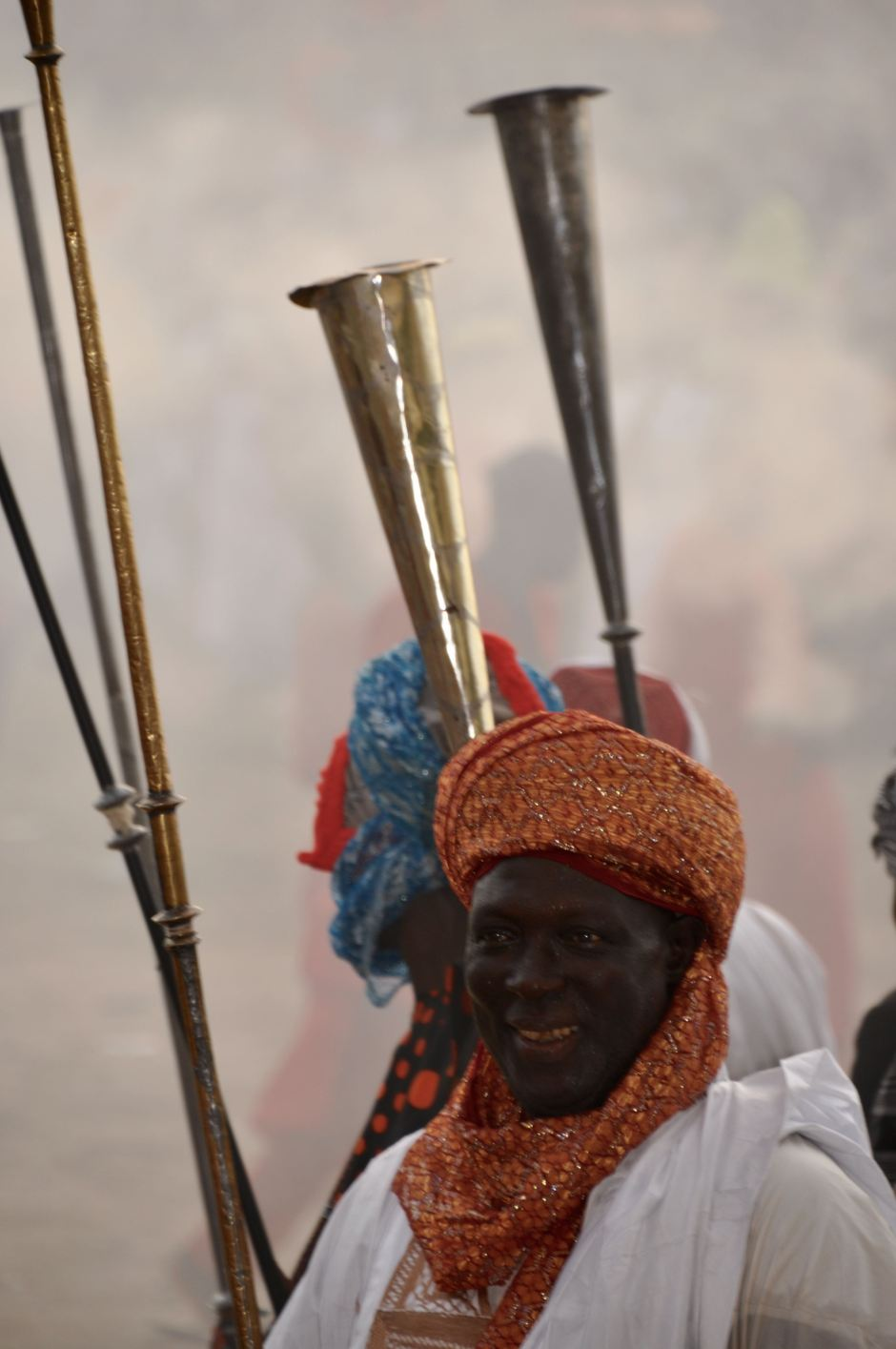 The trumpeters blow in one then the other. This type of trumpet is used only by the Emirs.